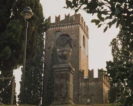 The medieval castle of the castle that sits on top of a hill and offers a wonderful view of the city of Conegliano.